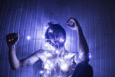 Topless Model trying to Untangle Christmas lights — Stock Photo