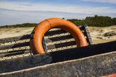 Orange Lifesaver on Old Fishing Ship — Stock Photo
