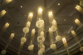 Golden Chandeliers in Hotel Casino — Stock Photo