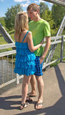 Beautiful girl walking with a young, confident guy — Stock Photo