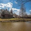 Ancient wooden temple stands on the banks of the river — Стоковая фотография