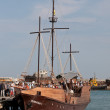 Stock Photo: Ancient sailing ship in port