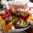 Fruit plate on restaurant table — Stock Photo