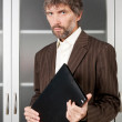 Man in suit with business papers — Stock Photo
