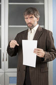 Angry man shows blanc sheet of paper — Stock Photo