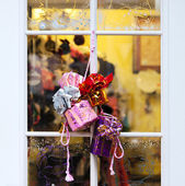 Gifts in holiday window — Stock Photo