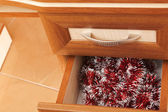Christmas garland in open desk drawer — Stock fotografie