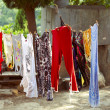 Washed clothes drying on the sun — Stock Photo