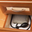 Tonometer in desk drawer — Stock Photo