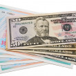 Stock Photo: Stack of dollar bills united states and shares