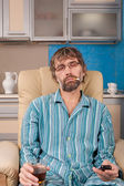 Drunk man sleeps with glass and cigarette — Stock Photo