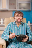 Man sitting in chair with pot — Stock Photo