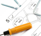 Tools with furniture assembling instruction sheet — Stock Photo
