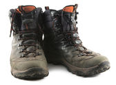 Well worn and muddy hiking boots — Stock Photo