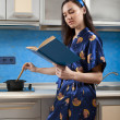 Housewife cooks food — Stock Photo
