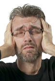 Mature man suffering from headache — Stock Photo
