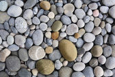 Background with round peeble stones — Stock Photo