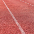 Straight lanes of running track — Stock Photo #22466833