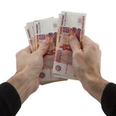 Man's hands recalculates cash in Russian rubles — Stock Photo