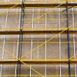 Concrete wall with scaffolding — Stock Photo