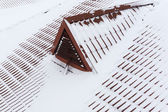 Snow on metal tiles roofing — Stock Photo