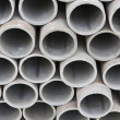 Pile of cement pipes - Stock Photo