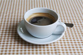 Cup of black coffee on table — Stock Photo
