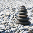 Pyramid of pebbles on the beach — Stock Photo