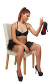 Young redheaded girl in black bra and tutu — Stock Photo