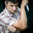 Royalty-Free Stock Photo: Guy with knife blade