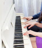 Сlose up view of hands playing piano — Stock Photo