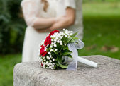 Wedding bouquet with red roses — Stock Photo