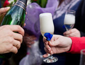 Champagne poured in to the glass — Stock Photo