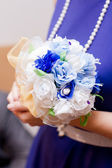 Bridal bouquet in the witness hands — Stock Photo