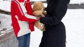 Happy couple with teddy bear — Stock Photo