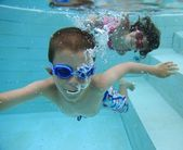 Swimming underwater — Foto Stock