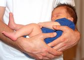 Safe in father's arms — Stock Photo