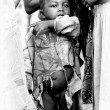 Half naked baby from Togo in a broken shirt — Stock Photo