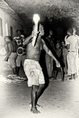 A man from Togo dances with a fire stick — Stock Photo