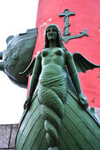 Monument of a mermaid at the rostral column in Saint Petersburg — Stock Photo