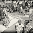 Stock Photo: Men, womrn and children from Togo participate in local fair