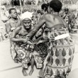 Stock Photo: Two ladies from Togo help their friend which loses control under voodoo enchantment