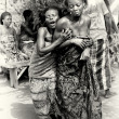 Stock Photo: Lady from Togo helps her friend which has lost control under voodoo enchantment