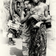 A lady from Togo helps her friend which has lost control under the voodoo enchantment — Stock Photo #12074107