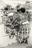 Two ladies from Togo help their friend which loses control under voodoo enchantment — Stock Photo
