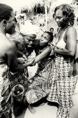 Three ladies from Togo help their friend which loses control under voodoo enchantment — Stock Photo