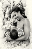 Happy woman from Togo and a baby — Stock Photo