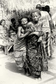 A lady from Togo helps her friend which has lost control under the voodoo enchantment — Stock Photo
