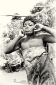 Woman from Togo shuts the ears — Stock Photo