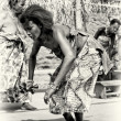 Stock Photo: Womfrom Togo dances with special instrument